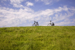 Two bikes on a dike in the Netherlands Royalty Free Stock Image