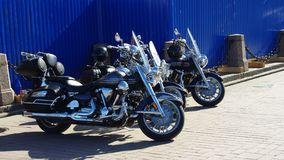Two bikes near the blue wall stock images