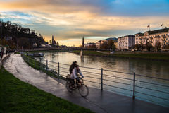 Two bikes next to Salzach river of Salzburg Stock Images