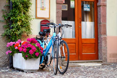 Two bikes parked on a street Royalty Free Stock Photos