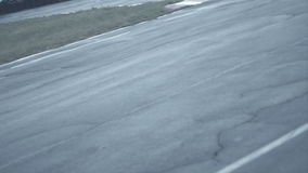 Two bikes pass a straight section of competition and come into a turn. Hd stock footage