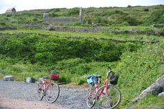 Two bikes. Sitting along a lonely path on the Aran Islands stock photography