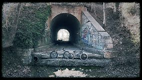 Two bikes with a tunnel in the background Stock Image