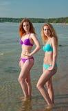Two bikini models posing on a beach. Royalty Free Stock Photos