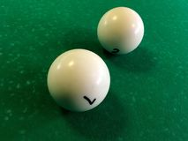 Two billiard balls on the table. Two billiard balls on the green table royalty free stock photos