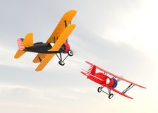 Two biplanes flying in the sky. Stock Photos