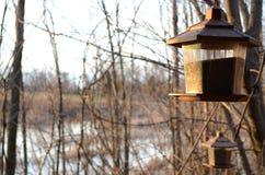 Two bird feeders Stock Photography