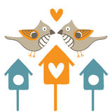 Two birds and birdhouses Royalty Free Stock Images
