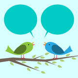 Two birds communicating. Two cute vector birds perched on branch communicating with each other. Place for your text, copy space. EPS 10 vector illustration, no Royalty Free Stock Photos