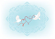 Two birds fly and carry in its beak decorative hearts Stock Images