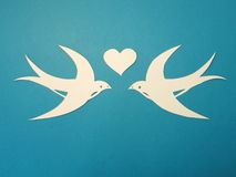 Two birds and heart. Paper cutting. Royalty Free Stock Photography