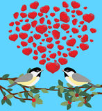 Two birds. Two love birds with hearts Royalty Free Stock Images