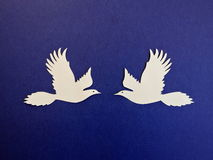 Two birds. Paper cutting. Stock Photo