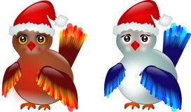 Two birds with Santa's hat Stock Photography