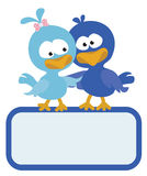 Two birds with sign Stock Photo