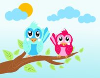 Two birds on twig of tree Stock Image