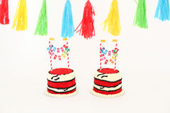 Two birthday cakes and a banner Royalty Free Stock Images