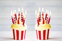 Two birthday small cakes on table closeup background royalty free stock photo