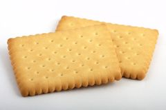 Two biscuits. For tea on a white background Royalty Free Stock Image