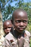 Two black African tribe maasai children, siblings. Meserani Snake Park, Arusha, Tanzania - February 14, 2008: Two unidentified children, a black boy about 8 stock image