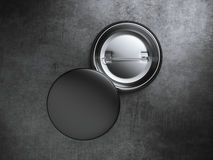 Two black blank badges on the concrete floor. 3d rendering Stock Image