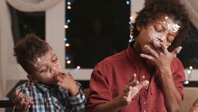 Two black boys destroying cake. stock video