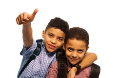 Two black boys after school. With thumbs up and hugging each other Stock Photo