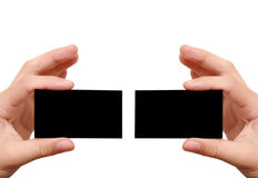Two black business cards in hands Stock Images