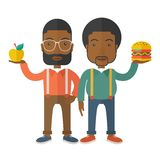 Two black businessmen comparing apple to hamburger Royalty Free Stock Photos