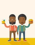 Two black businessmen comparing apple to hamburger Stock Photos