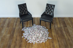 Two Black Chairs In Minimalist Interior With Stack Of Money Stock Image