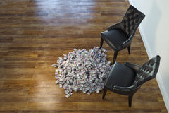 Two Black Chairs In Minimalist Interior With Stack Of Money Royalty Free Stock Photo