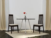 Two black chairs and a table Royalty Free Stock Photo