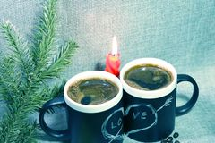 Two black circles with a symbol of love with a red candle and a branch of spruce. Heart pierced by an arrow drawn in white chalk royalty free stock photos