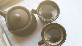 Two black coffee cups and clay ibrik on the wooden salver stock video