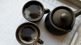 Two black coffee cups and clay ibrik on the wooden salver stock video footage