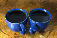 Two Black Coffees in Blue Mugs. Two cups of black coffee in blue marbled mugs Royalty Free Stock Image