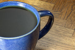Two Black Coffees in Blue Mugs. Two cups of black coffee in blue marbled mugs Royalty Free Stock Photos