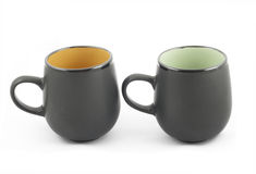 Two black cups on white. Two black cups for tea on white background Stock Photos