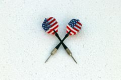 Two black dart with United state of America flag of the wing on the white foam stock images