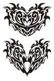 Two black demonic monsters hearts in tribal style Stock Photo
