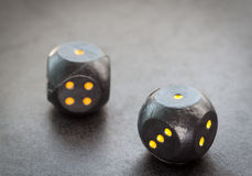 Two black dice. Royalty Free Stock Images