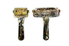 Two black dirty paint rollers be stained color. Isolated on white background Stock Photo