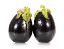Two black eggplants on white Royalty Free Stock Image