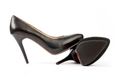 Two black female shoes, suede and leather ones. Over white background Stock Image