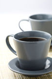 Two black filter coffees. A close-up of two cups of black filter coffee on a table mat Stock Photos