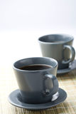 Two black filter coffees. A close-up of two cups of black filter coffee on a table mat Royalty Free Stock Photo