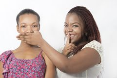 Two Black friends Speak no evil hand. Hand gesture speak no evil with hands royalty free stock image