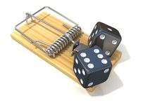 Two black game dices, like bait, in wooden mousetrap Royalty Free Stock Images