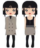 Two Black Haired Female Paper Dolls. In Brown And Black Tights, Coats And Dresses Royalty Free Stock Image